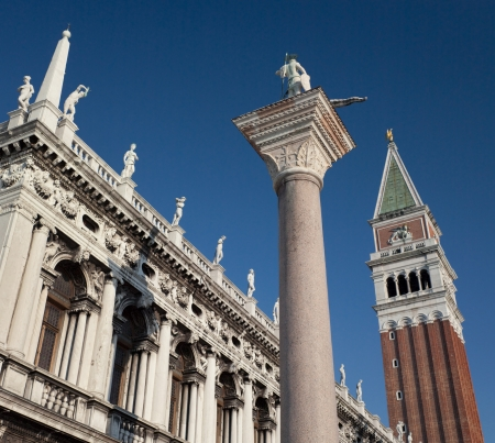 st  marks square: The Campanile and Colonne di San Marco San Teodoro in St Marks Square - San Marco - in Venice in northern Italy  Editorial