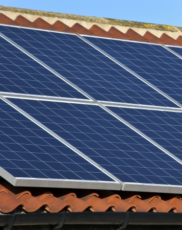 Solar heating Photovoltaic panels on the roof of a house  Hot water heated by the sun in a residential setting to provide domestic hot water, solar hot water also has industrial applications, such as generating electricity  Designs suitable for hot climat Stock Photo - 20398762