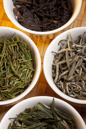 A selection of Chinese Herbal Teas  They are; Ji Xin Yi Wu, Anji Bai Cha, Jasmine Silver Needle and Dragon Well Long Jing  photo