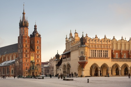 Church of St. Mary and the Cloth Hall in the main Market Square (Rynek Glowny) in the city of Krakow in Poland.