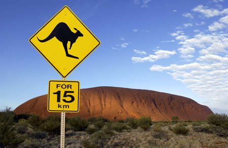 Road sign near Ayers Rock in the Northern Territory of Australia. It is the largest monolith in the world, at 348 m high and about 9 km in circumference. Aboriginal name Uluru. It is a UNESCO World Heritage Site. Editorial