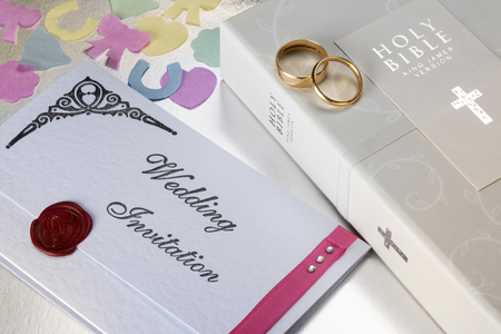A Wedding Invitation and Holy Bible  Stock Photo