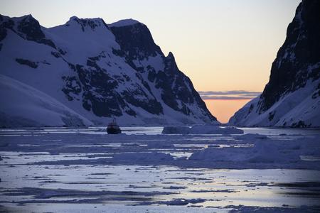 antarctic peninsula: Midnight sun  at 3am  in the Lamaire Channel on the Antarctic Peninsula in Antarctica