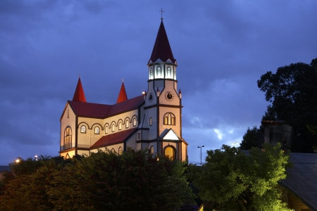 Floodlit wooden church in Puerto Varas in Chile, South America  photo
