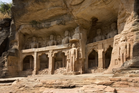 human being: 7th century Jain sculptures depicting the Tirthankaras near Gwalior Fort in the of town of Gwalior in the Madaya Pradesh region of India  In Jainism, a Tīrthaṅkara is a human being who achieves moksa  enlightenment  Stock Photo