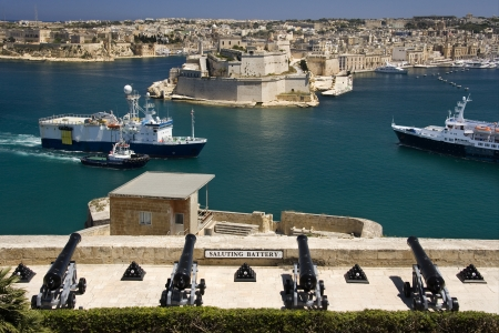 escorted: Shipping - Vessels being escorted to the busy docks in the Grand Harbor in Valletta, Malta