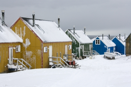 inuit: Houses in the town of Ittoqqortoormiit  pop  551  at the entrance to Scoresbysund in eastern Greenland