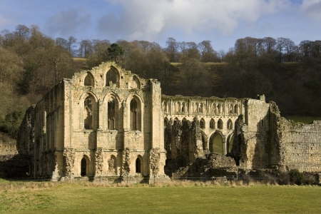 abbot: Rievaulx Abbey is a former Cistercian abbey headed by the Abbot of Rievaulx  It is located in Rievaulx, near Helmsley in the North York Moors National Park, North Yorkshire, England