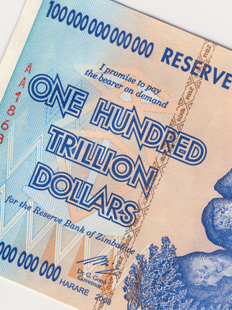 billion: A banknote of one hundred trillion dollars, from Zimbabwe  This banknote has the highest nominal value in history  The hyper-inflation in Zimbabwe in 2008 and 2009 broke every record  Stock Photo