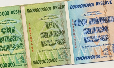 Banknotes of Zimbabwe including a banknote of one hundred trillion dollars  This banknote has the highest nominal value in history  The hyper inflation in Zimbabwe in 2008 and 2009 broke every record  photo