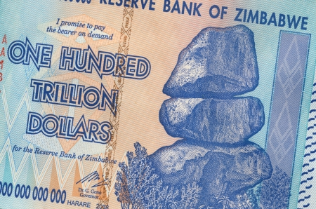Banknote of Zimbabwe of one hundred trillion dollars. This banknote has the highest nominal value in history. The hyper-inflation in Zimbabwe in 2008 and 2009 broke every record. Stock Photo