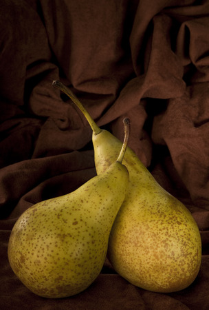 pyrus: Two Pears - An edible fruit that is typically narrow at the stalk and wider toward the tip, with sweet, slightly gritty flesh  The pear is the fruit of a tree of genus Pyrus