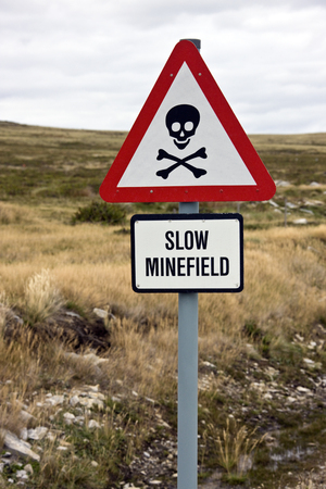 falklands war: Danger Minefield sign near a road in the Falkland Islands  Islas Malvinas