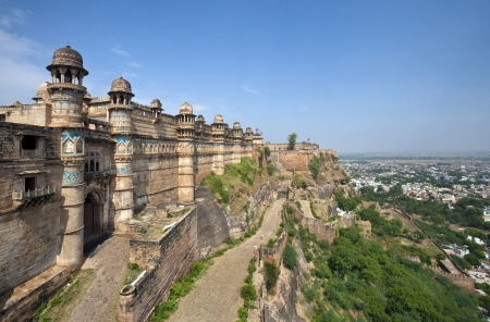 Gwalior Fort is in the city of Gwalior, in the central Indian state of Madhya Pradesh  It stands on an isolated rock, overlooking Gwalior  It is one of the biggest forts in India