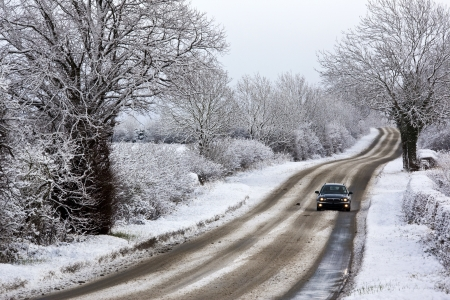 Driving in winter snow on a country road in North Yorkshire in the United Kingdom photo