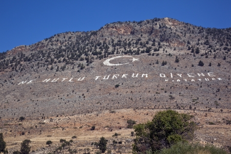 disputed: Turkish Republic of Northern Cyprus - Ataturk quotation on a hillside that overlooks the disputed border to the southern  Greek  side of Cyprus