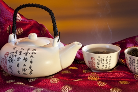 Chinese Green Tea is tea that is made from unfermented leaves and is pale in color and slightly bitter in flavor, produced mainly in China and Japan  Green tea is made solely with the leaves of Camellia sinensis that have undergone minimal oxidation durin Standard-Bild