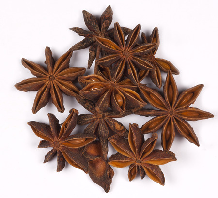 ingedient: Spices - Star Anise is a small star-shaped fruit with one seed in each arm  It has an aniseed flavor and is used unripe as a spice in Asian cooking  Stock Photo