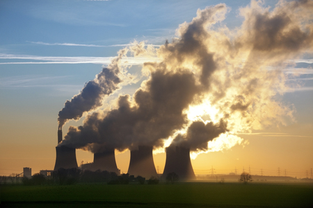 Late afternoon sun through the steam from the cooling towers of a Power Station in Lincolnshire in the United Kingdom  photo
