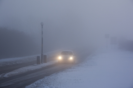 driving conditions: Winter driving in freezing fog on a country road in Yorkshire in the United Kingdom