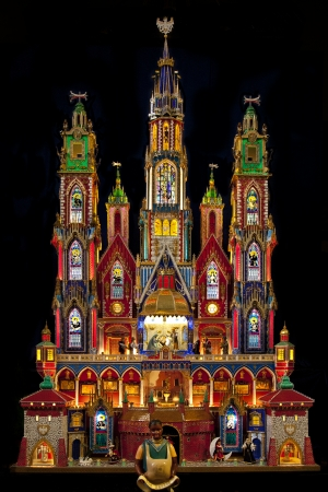 A traditional Krakow Nativity Scene at Christmas in the Franciscan Church in the city of Krakow in Poland  These colorful structures are unique to Krakow  An annual nativity scene contest is held each December in Krakow