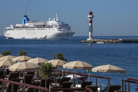 cote d'azure: Cruise Liner moored just off the beach at Cannes on the Cote d Azure in the South of France Stock Photo
