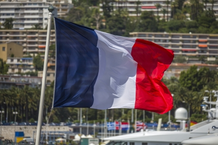 d���azur: The national flage of France  Nice on the Cote d Azur in the South of France Stock Photo
