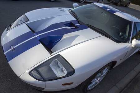 wider: The Ford GT is a 5 4 litre V8 mid-engine two-seater sports car  The GT is similar in outward appearance to the original Ford GT40 raceing cars, but bigger, wider, and 3 in  76 mm  taller than the original GT40   Editorial