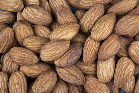 almond tree: Almonds are the oval seed  kernel  of the almond tree  The fruit of the almond is a drupe, consisting of an outer hull and a hard shell with the seed  which is not a true nut  inside