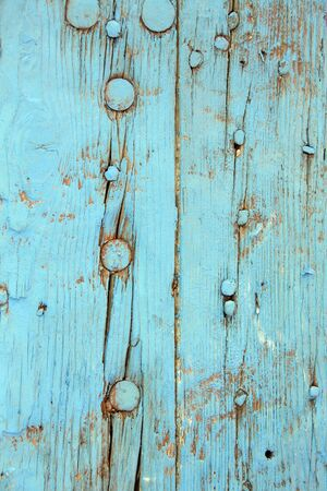 flaking: Peeling paint on an old door