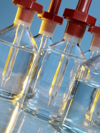 analytical chemistry: Reagent bottles in a school Science Laboratory Stock Photo