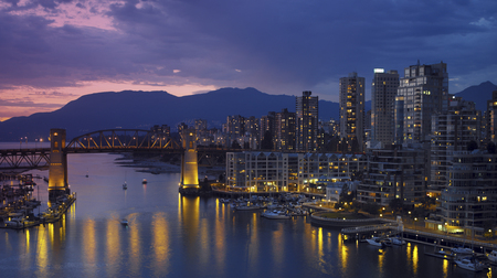 Yaletown and the Burrard Bridge in False Creek in the city of Vancouver, British Columbia in Canada