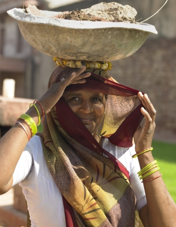 Indian woman working near the landmark of Fatehpur Sikri in the Uttar Pradesh region of northern India Editorial