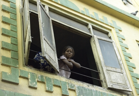 Child living in slum housing in the city of Udaipur in the Rajasthan region of western India.