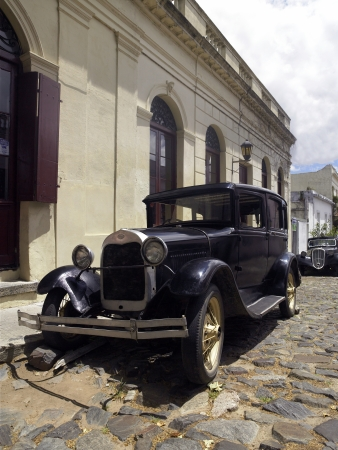 colonia del sacramento: Old cars being used as a street ornament in the UNESCO World Heritage town of Colonia del Sacramento in Uruguay, South America.