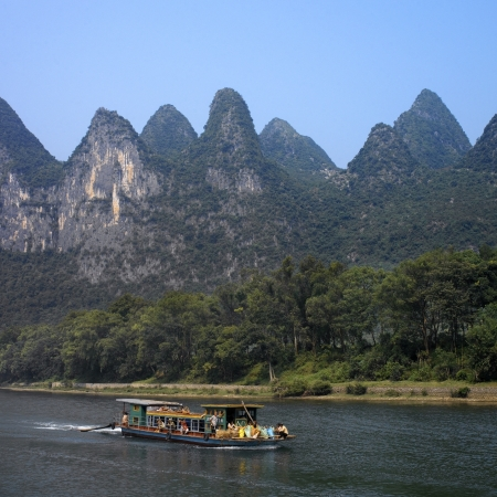 The Li River is in Guangxi Zhuang region of China. It ranges 83 kilometers from Guilin to Yangshuo, where the Karst mountains are a famous landmark.