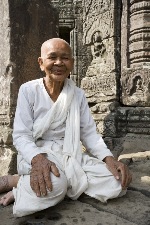 iconography: Buddhist Nun at the Bayon Temple in Angkor Wat in Cambodia. This is a UNESCO World Heritage Site. Editorial