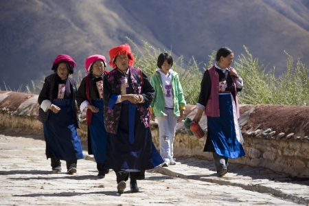 gelugpa: Local women at Ganden Monastery in Tibet. Ganden is the one of the most important Gelugpa monasteries and is high in the Himalayas at an altitude of 4500m (14,760ft).