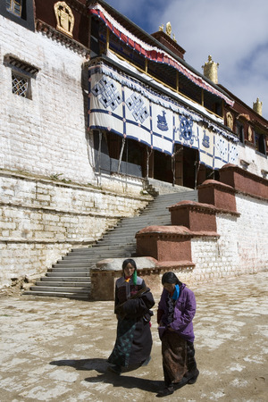 gelugpa: Local Tibetan women at Ganden Monastery in Tibet. Ganden is the one of the most important Gelugpa monasteries and is high in the Himalayas at an altitude of 4500m (14,760ft).