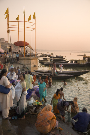 Dawn on the Hindu ghats on the banks of the Holy River Ganges  Ganga  in Varanasi  Benares  in the Uttar Pradesh region of northern India