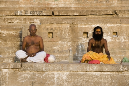 Hindu devotions at the Ghats on the Holy River Ganges in Varanasi in the Uttar Pradesh region of northern India