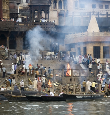 Hindu Cremation Ghats on the banks of the Holy River Ganges (Ganga) in Varanasi (Benares) in the Uttar Pradesh region of northern India.