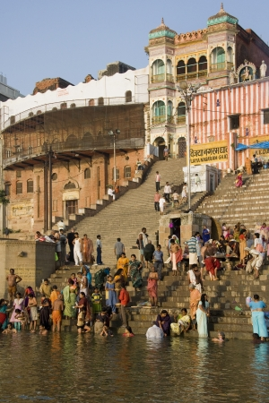Hindu Ghats on the banks of the Holy River Ganges (Ganga) in the city of Varanasi (Benares) in the Uttar Pradesh region of India.
