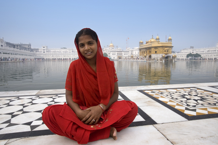 Young Sikh girl at the Golden Temple of Amritsar in the Punjab region of northern India. The Golden Temple (Harmandir Sahib) is the holiest shrine in Sikhism.