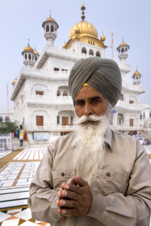 governing: A Sikh man standing by the Akal Takht at the Golden Temple in Amritsar in the Pubjab in northern India. The Akal Takht is the seat of the supreme governing body of the Sikh religion.