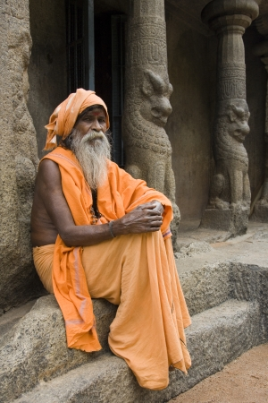 Hindu Holy Man at a monalthic Hindu Temple in Mahabalipuram in the Tamil Nadu region of southern  India
