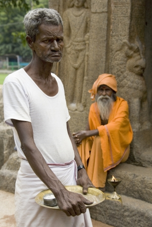 Hindu Holy Men at a monalthic Hindu Temple in Mahabalipuram in the Tamil Nadu region of southern  India Stock Photo - 22358945