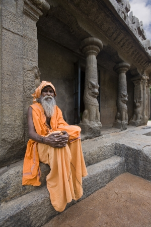 mamallapuram: Hindu Holy Man at a monalthic Hindu Temple in Mahabalipuram in the Tamil Nadu region of southern  India