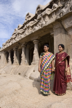 monolithic: Two Indian women at the Monolithic temples of the Panch Rathas in Mahabalipuram in the Tamil Nadu region of southern India.