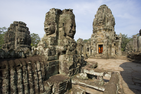 iconography: Bayon Temple near Angkor Wat in Cambodia in South East Asia. This is a well-known and richly decorated Khmer temple at Angkor and was built in the late 12th century or early 13th century as the official state temple of the Mahayana Buddhist King Jayavarma